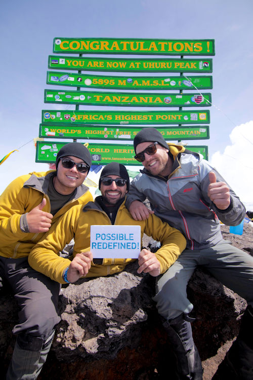Spencer (centre) with Alex (left) and David at the summit of Mt. Kilimanjaro. They were able to raise well over their goal of half a million dollars and provide funding for clean water to 12,500 people for life in East Africa.