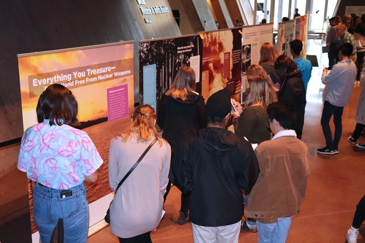 "Students viewing the ""Everything You Treasure-For a World Free from Nuclear Weapons"" exhibition"